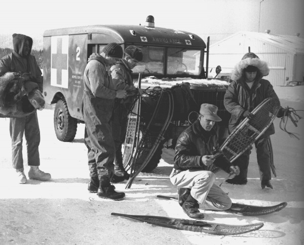GROUND PARTY PREPS -- This was one of the first groups of ground searchers who reached the scene of Thursday's crash of a B-52 on Elephant Mountain near Greeenville. The group tries on snowshoes and tests gear prior to tackling deep snow and stiff climbing to the crash scene. They were based at Greenville until a road could be cleared to within a mile of the area.