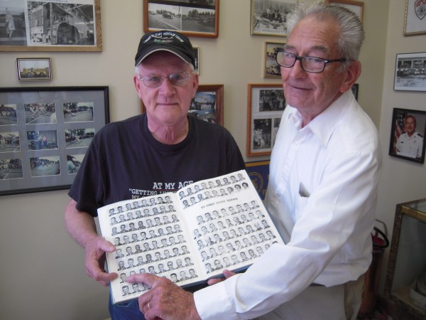 Howard Burson of Limestone (right) points to a picture of Charles Hash of Caribou (left) in a 1963 Loring Air Force Base yearbook at the Loring Military Heritage Center in Limestone. Burson once patrolled the nuclear weapons storage area on the base and Hash served in the 42nd Food Service Squadron.