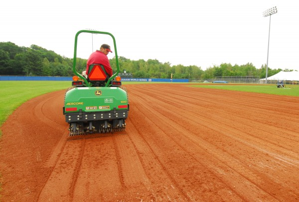A field crew worker uses a tractor to prep the infield at Mansfield Stadium on Friday morning. Bangor hosts the first game of the Senior League World Series against Canada at noon Sunday.