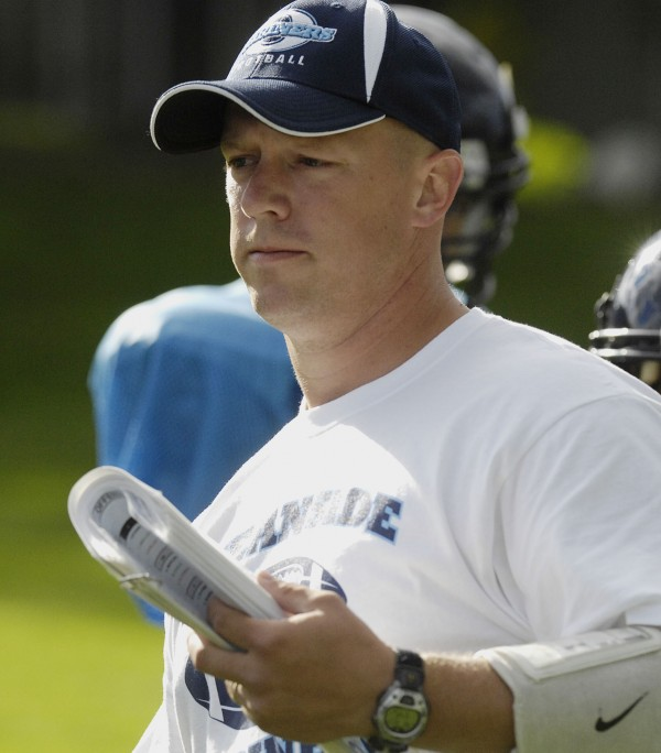 Woody Moore has returned as head coach of the Oceanside High School football team.