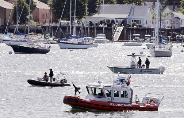 The Coast Guard, Maine Marine Patrol and others search for the body of Coast Guardsman Vincent Colon in September 2007 in Portland.