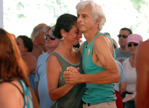 Lissa Widoff of Freedom and Peter Baldwin of Brooks share a dance to salsa band La Excelencia in the Dance Pavilion on Saturday afternoon, Aug. 25, 2012, at the American Folk Festival in Bangor.