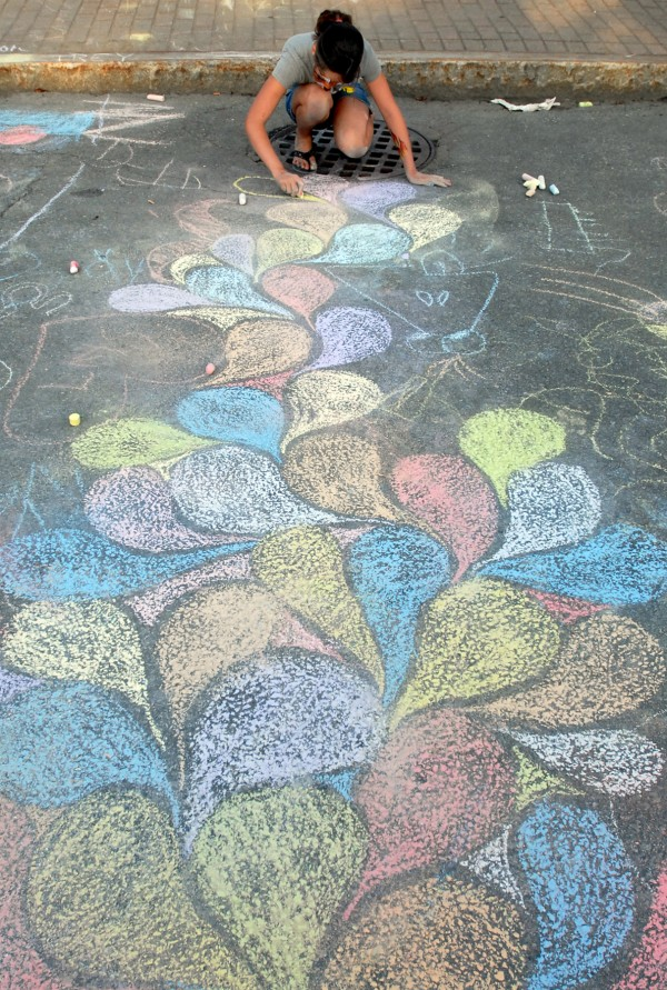 Megan Leveille, 11, of Bucksport spent almost two hours creating her artwork using sidewalk chalk at the Children's Village Saturday afternoon, Aug. 25, 2012, at the American Folk Festival in Bangor.