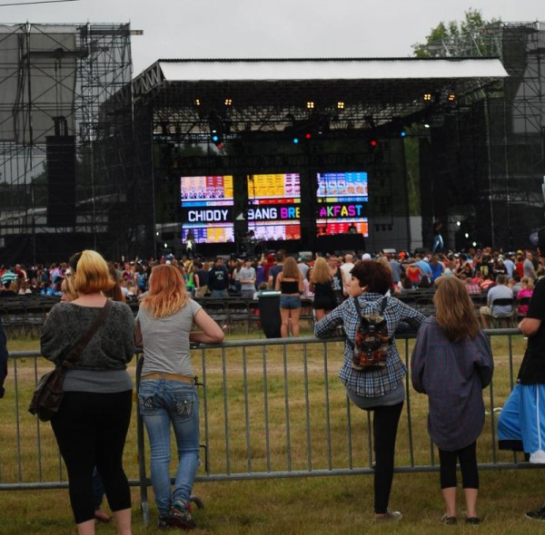 An estimated 6,000 fans attended Tuesday night's concert headlined by Wiz Khalifa and Mac Miller at Scarborough Downs. Police reported about two dozen people were treated for heat exhaustion and dehydration, and there were a few arrests and expulsions. The show was the first of three large-scale concerts to be held at the track this summer.