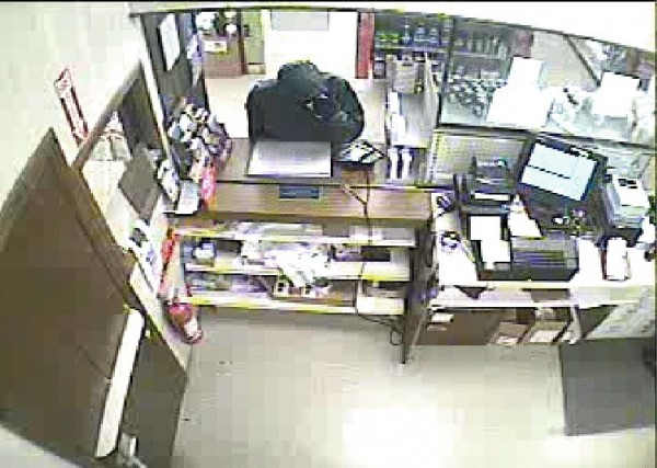 This video surveillance still, taken around 7 p.m. Wednesday at Rite-Aid in Bucksport, shows the man police say robbed the pharmacy. Police are seeking information that could lead to the man's identity.