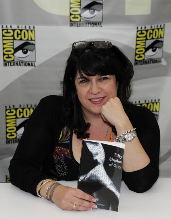 Author E.L. James poses with her book &quotFifty Shades of Grey&quot at a book signing during the first day of Comic-Con convention held at the San Diego Convention Center on Thursday, July 12, 2012, in San Diego.