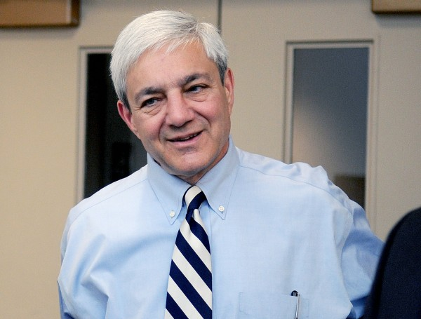 Penn State President Graham Spanier arrives at the University Park Airport  in State College, Pa. in July 2012. Spanier and his lawyers attacked the university-backed report on the Jerry Sandusky sex abuse scandal on Wednesday, Aug. 22, 2012, in Philadelphia, calling it a &quotblundering and indefensible indictment&quot as they fired a pre-emptive strike while waiting to hear if he'll be charged in the case.