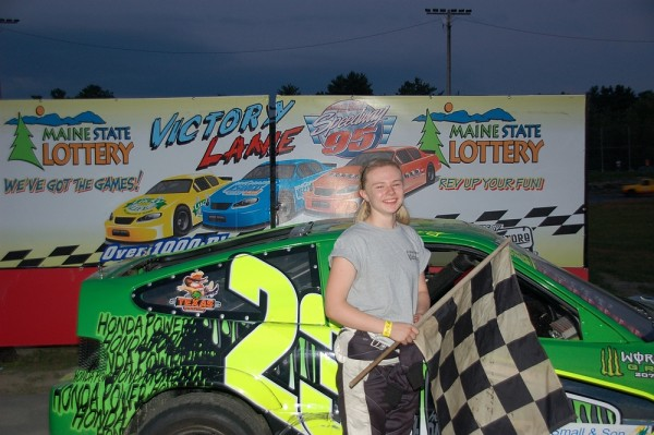 Emma Libby stands in front of her car after a recent victory at Speedway 95 in Bangor.
