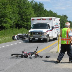 Three hospitalized in bicycle-motorcycle accident