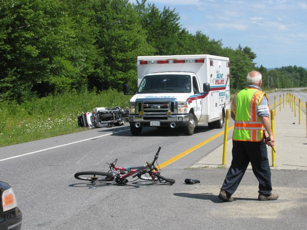 Belfast Fire Chief Jim Richards works Monday afternoon, Aug. 6, 2012, at the Route 1 scene of a crash between a teenage girl on a bike and a Michigan couple on a motorcycle. All three were transported to Waldo County General Hospital.