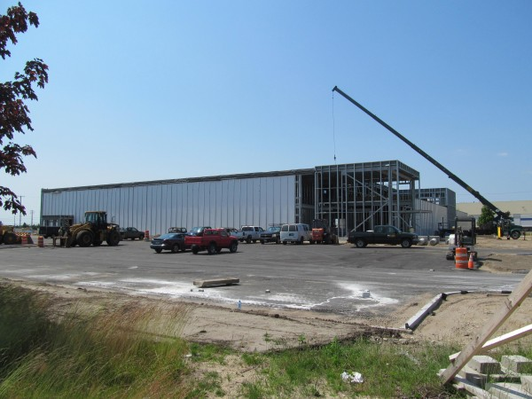 A building is under construction in June 2012 at the former Brunswick Naval Air Station by an organization called Molnlycke Health Care.