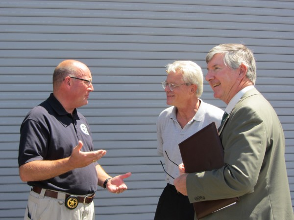 Maine U.S. Marshal Noel March (from left) talks with Lyman Morse Boatbuilding Chief Financial Officer Bruce Hopkins and attorney Leonard Langer of Portland, Maine, following the court-ordered auction of a 70-foot sail boat on Wednesday, Aug. 1, 2012.