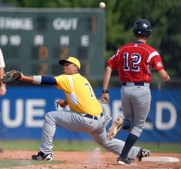 West's first baseman Deandre Simpson misses a throw allowing Central's Devin Husted to take first in the  third inning of Friday afternoon's Senior Little League World Series semifinal game. Lemon Grove, Calif. won 6-1 and advances to the championship game Saturday.