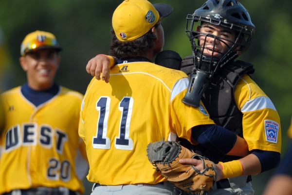 U.S. West pitcher Frankie Nunez and catcher Dominik Sawyer of Lemon Grove, Calif., celebrate after beating U.S. Central of Grand Rapids, Mich., 6-1 in a Senior League World Series semifinal at Mansfield Stadium in Bangor Friday. U.S. West meets Latin America for the title at 2 p.m. Saturday.