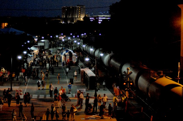 A train passes through the American Folk Festival on the Bangor Waterfront Saturday night, Aug. 25, 2012.