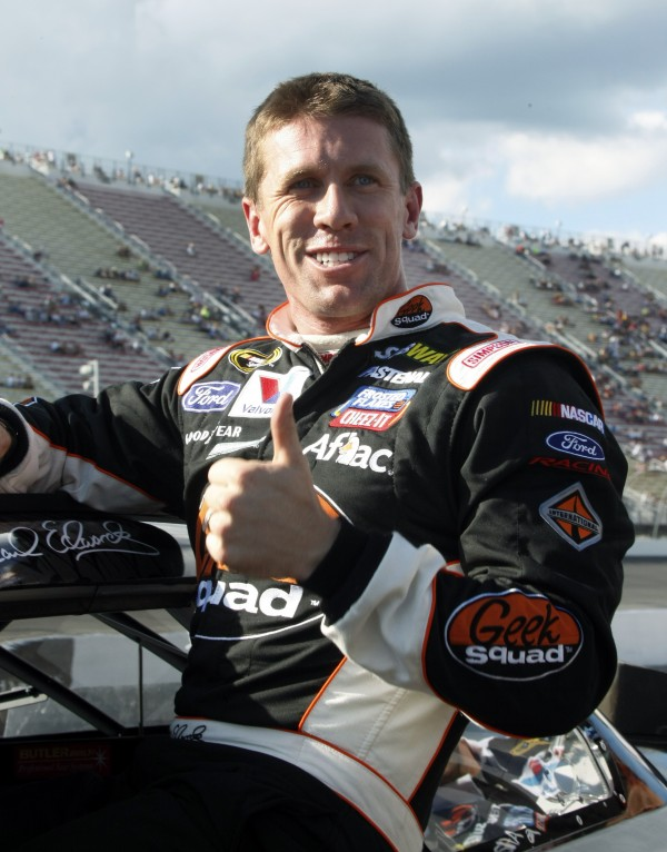 Carl Edwards gives a thumbs-up after qualifying for the NASCAR Sprint Cup Series auto race at Michigan International Speedway on Friday, Aug. 17, 2012, in Brooklyn, Mich. Edwards took second spot in qualifications.