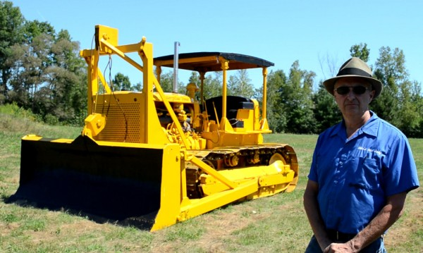 Mike Braley, owner of Mike's Auto Body in Pittsfield, shows off his fully restored 1939 Caterpillar D7 bulldozer on Wednesday, Aug. 8, 2012. He said it took about two years and more than 400 hours to return the 20-ton machine its original condition.