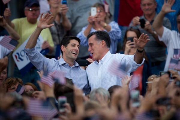 Republican vice presidential candidate Paul Ryan of Wisconsin (left) and Republican presidential candidate Mitt Romney wave to the crowd at the Waukesha County Expo Center on Sunday, August 12, 2012 in Waukesha, Wisconsin.