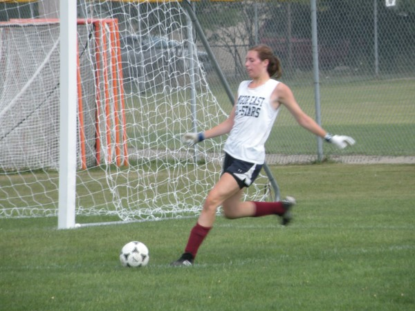 Cordelia Stewart, a goalkeeper for the defending Class A state champion Bangor High School girls soccer team, puts a ball back into play during the opening day of practice at the Union Street Complex on Monday, Aug. 13, 2012.
