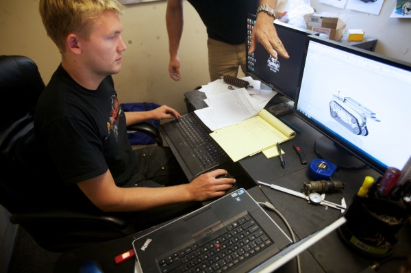Chief engineer Josh Spaulding of Howe and Howe Technologies in Waterboro works on designing a new SWAT team application for the company's remote controlled RS1 vehicle Monday, Aug. 13, 2012.