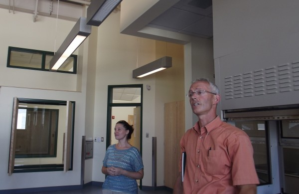 Old Town High School science teacher Ed Lindsey and art teacher Rachel Betterley show off laboratory features and technology in the school's $5.3 million science and art wing. Work is nearing completion at the facility, where students will begin learning and researching in two weeks.
