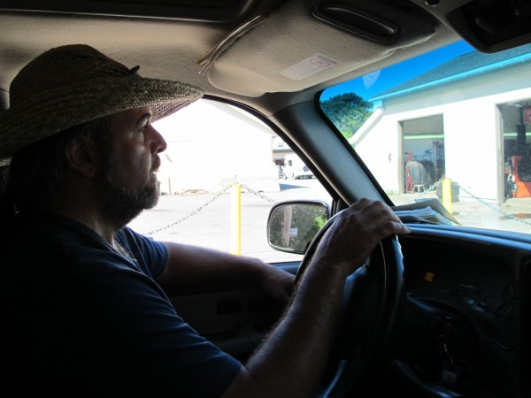 Chris Brown drives through Bar Harbor during his daily &quotpull,&quot stops to area businesses where he'll glean food to feed people and pigs.