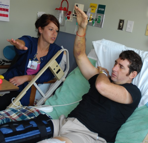 Thad LaVallee continues to recover at The Aroostook Medical Center from injuries he suffered in a bicycling accident 10 days ago. Part of his treatment includes rehabilitation work with Michaela St. Onge, TAMC occupational therapist.