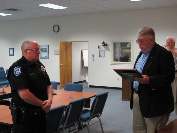 Rockland Police Sgt. Don Finnegan (left) was honored Monday night, Aug. 13, 2012 for 20 years of service to the city. He was presented a plaque by Mayor Brian Harden.
