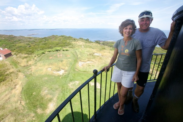 Seguin Island Lighthouse summer caretakers Beverly and David Ramsey stand atop the 1857-era tower Tuesday, Aug. 15, 2012. Beverly first came to the island when she was six days old and her parents were stationed there with the Coast Guard.