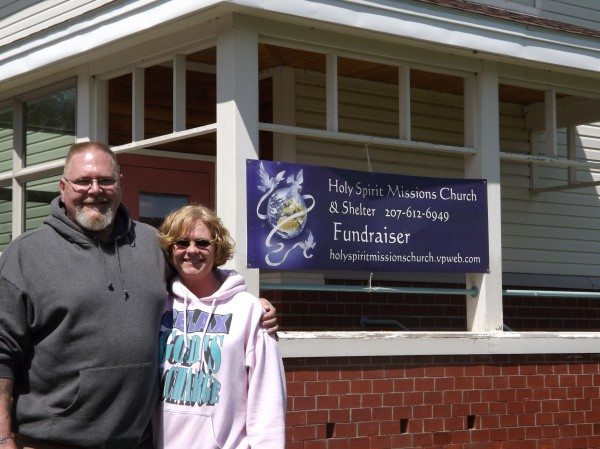The Rev. John Weeks and his wife, Linda, stand in front of Holy Spirit Missions Church and Shelter in Parkman on Thursday, May 21, 2012. Weeks, also known as Pastor Jack, is attempting to raise $20,000 as a down payment to buy the former McKusick Elementary School.