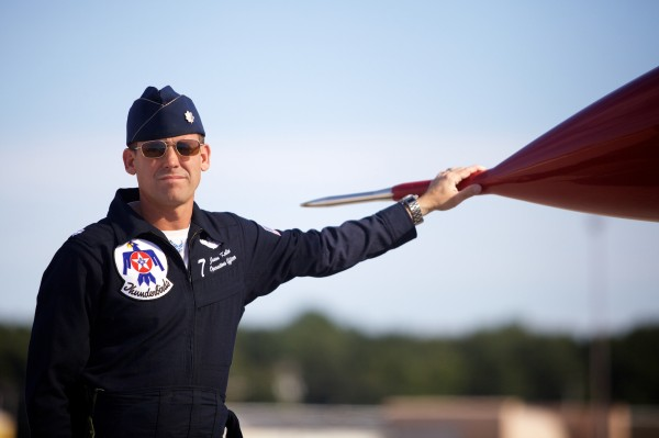 U.S. Air Force Thunderbirds pilot Lt. Col. Jason Koltes shares a moment with his plane in the tarmac in Brunswick Wednesday, August 22, 2012.