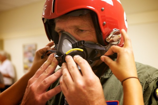 Nick Knobil of Topsham gets fitted with an air mask before a flight with the U.S. Air Force Thunderbirds in Brunswick Wednesday, August 22, 2012. Knobil is involved with Big Brothers-Big Sisters, Rotary and the Red Cross.