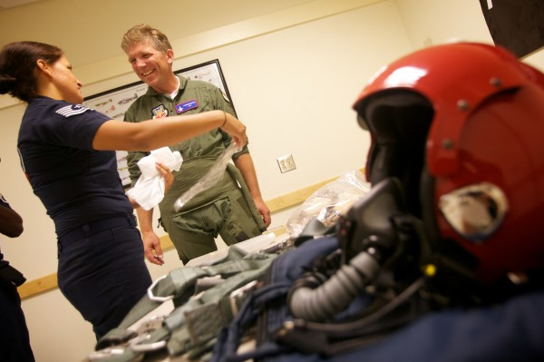 Tech. Sgt. Amber Alumpe acquaints Nick Knobil of Topsham with the air sickness bag before a flight with the U.S. Air Force Thunderbirds in Brunswick Wednesday, August 22, 2012. Knobil is involved with Big Brothers-Big Sisters, Rotary and the Red Cross.
