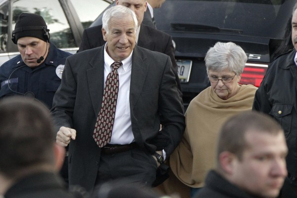 Former Penn State assistant football coach Jerry Sandusky arrives with his wife, Dottie Sandusky, for a preliminary hearing at the Centre County Courthouse in Bellefonte, Pa., in December 2011.