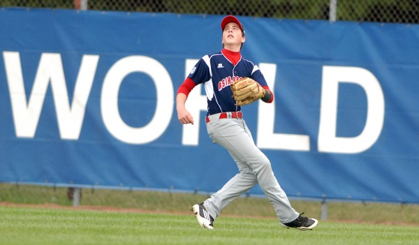 Auckland, New Zealand's right fielder Max Key warming up before Sunday evening's Senior Little League World Series game against Houston, Texas at Mansfield Stadium in Bangor, Maine.