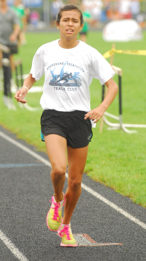 Faith Ely of Kennebunk finishes the 3000-meter run at a time of 12 minutes, 11 seconds in the Midget class, at the youth state track and field championships held at Brewer Community School, Sunday, Aug. 12 2012.