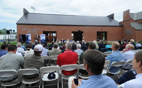 View of the crowd assembled for the dedication of the new Paul Mitchell Batting Pavilion (seen in background) at the University of Maine in Orono on Tuesday afternoon, Aug. 21, 2012.