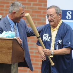 After presenting him with a team jersey, UMaine baseball head coach Steve Trimper presents UMaine trustee Paul Mitchell (right) with an honorary bat embossed with Mitchell's name during Tuesday's dedication ceremony for the new Paul Mitchell Batting Pavilion at the University of Maine in Orono. Coach Trimper was laughing because Mitchell had just asked him if he could get a replacement bat if he were to break it.