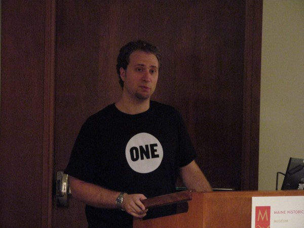 Mike Salamon, East Coast Field Organizer for the ONE Vote campaign, addresses a Portland audience Tuesday night, Aug. 21, 2012. The ONE campaign was co-founded by Bono, singer of the rock band U2, and is dedicated to reducing poverty and disease in underdeveloped countries.