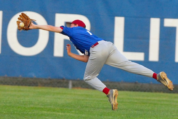 Bangor right fielder Andrew Hillier makes a diving catch in the sixth inning of play against Holbrook of Holden at Mansfield Stadium in Bangor on Wednesday, Aug. 8, 2012.