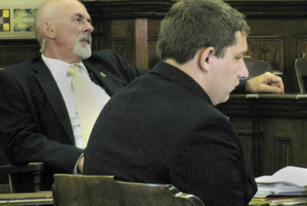 Luke Bryant sits at the defendant's table Tuesday morning during the opening day of his manslaughter trial for the 2011 gunshot death of his 19-year-old friend Tyler Seaney.