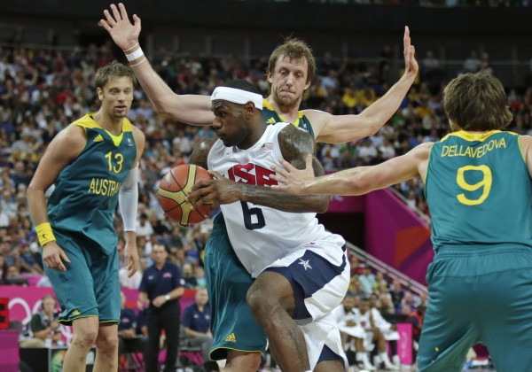USA's LeBron James (6) drives to the basket against Australia during a men's quarterfinals basketball game at the 2012 Summer Olympics, Wednesday, Aug. 8, 2012, in London.  From left are Australia's David Andersen, Matt Nielsen and Matt Dellavedova.