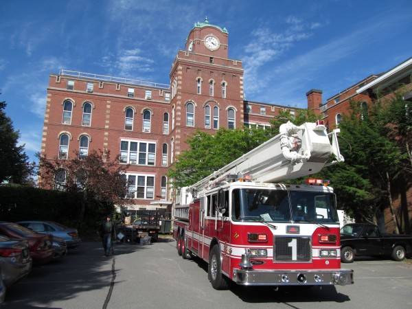 A Portland Fire Department ladder truck is parked at the old North School building near the corner of Congress and India streets early Wednesday evening, Aug. 22, 2012. Firefighters responded to a fire alarm at the site and evacuated the building, only to discover that it was a case of someone mistaking a bed bug bomb for fire smoke.