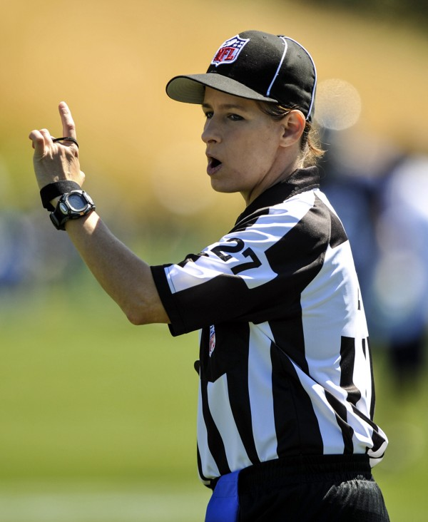 In this photo taken on Saturday, Aug. 4, 2012, and provided by the Seattle Seahawks, NFL official Shannon Eastin works during the Seahawks NFL football training camp in Renton, Wash. Eastin makes her NFL debut Thursday night as the line judge when the Green Bay Packers play at San Diego in the preseason opener for both teams.