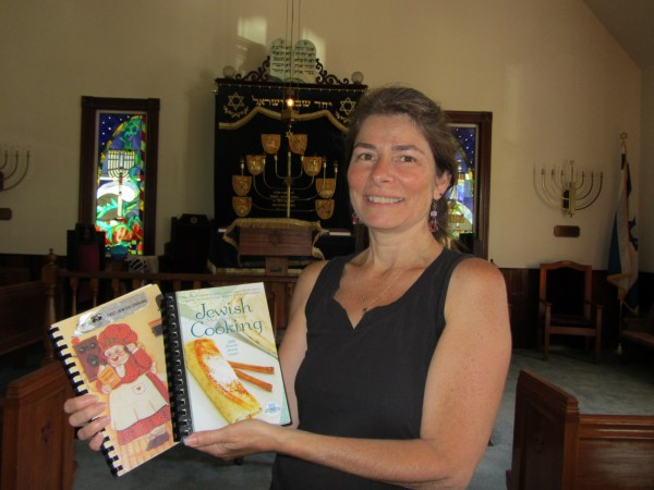 Lisa Breheny displays a copy of both the Adas Yoshuron Synagogue cookbook from 25 years ago as well as the new one that will go on sale beginning 6:30 Wednesday evening, Aug. 8, 2012 at the synagogue in Rockland.