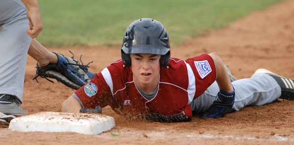 Michael Turner of the Maine District 3 team is safe back at first base in a pick off attempt during the 3rd inning of Tuesday evening's Senior Little League World Series game against U.S. East. Auburn, Massachusetts won the game 11-0.