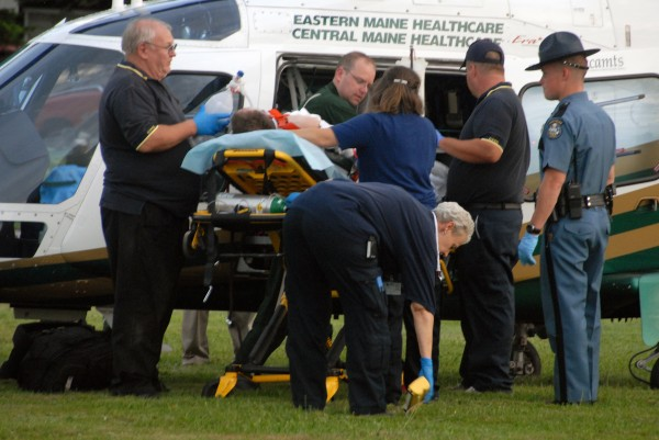 Warren Frederick Dome, 54, of Edinburg, who was reportedly shot by Trooper Chris Hashey during some kind of domestic disturbance at his home on Edinburg Road, is loaded into a LifeFlight helicopter off Route 6 in Howland on Tuesday, Aug. 14, 2012.