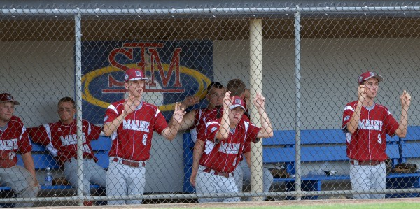 Maine District 3 players watch their teammates at bat during their Senior Little League World Series game against the U.S. East team at Mansfield Stadium Tuesday evening. Auburn, Mass., won the game 11-0 in 5 innings.