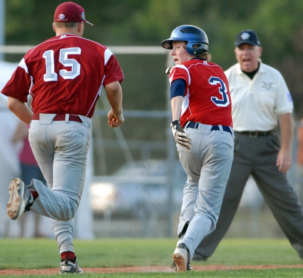 Central's Brad Burns gets caught in a rundown and is tagged out by Maine District 3's Michael Ward at third base in the 5th inning of Monday evening's Senior Little League World Series game at Mansfield Stadium. U.S. Central, from Grand Rapids, Michigan, won the game 8-5.
