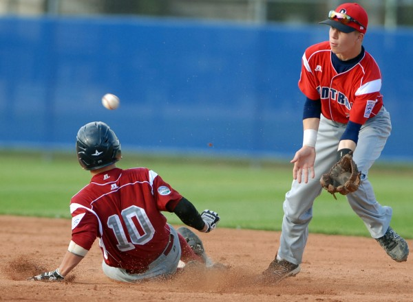 Tristan Gardner, Maine District 3, slides into second before Central second baseman Zackaria Zobro has the ball in the 3rd inning of Monday evening's Senior Little League World Series game at Mansfield Stadium. U.S. Central from Grand Rapids, Michigan won the game 8-5.